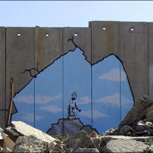 Where Protests Failed, Banksy Art Frenzy Takes Down a Wall